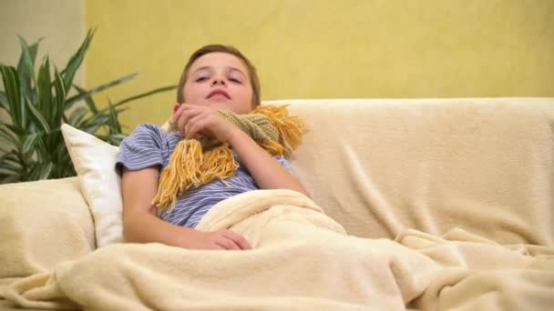 Sick child boy lying in bed