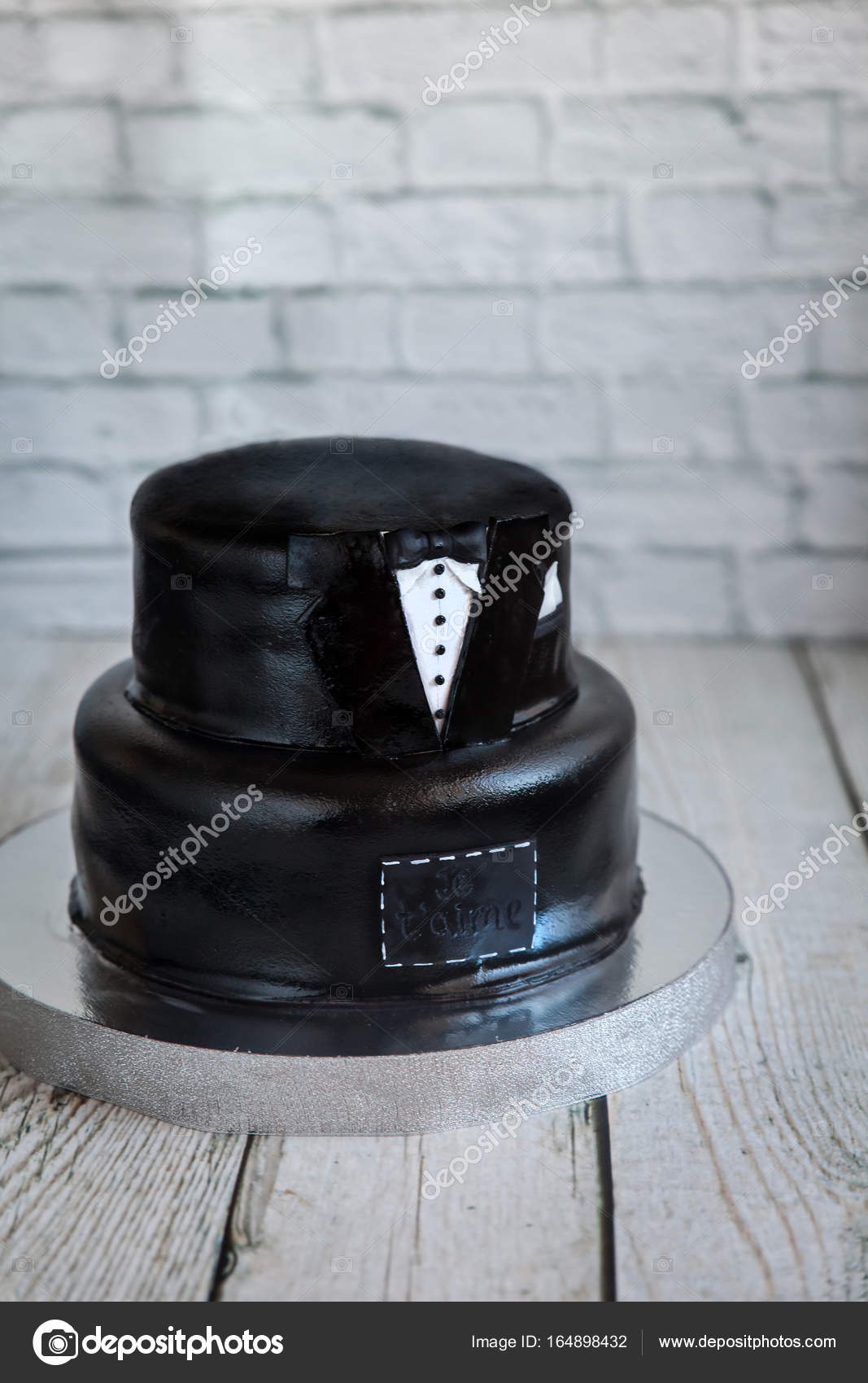 White and black tuxedo wedding or birthday cake — Stock Photo ...