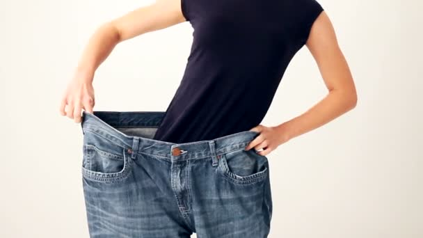 Woman in jeans of much bigger size