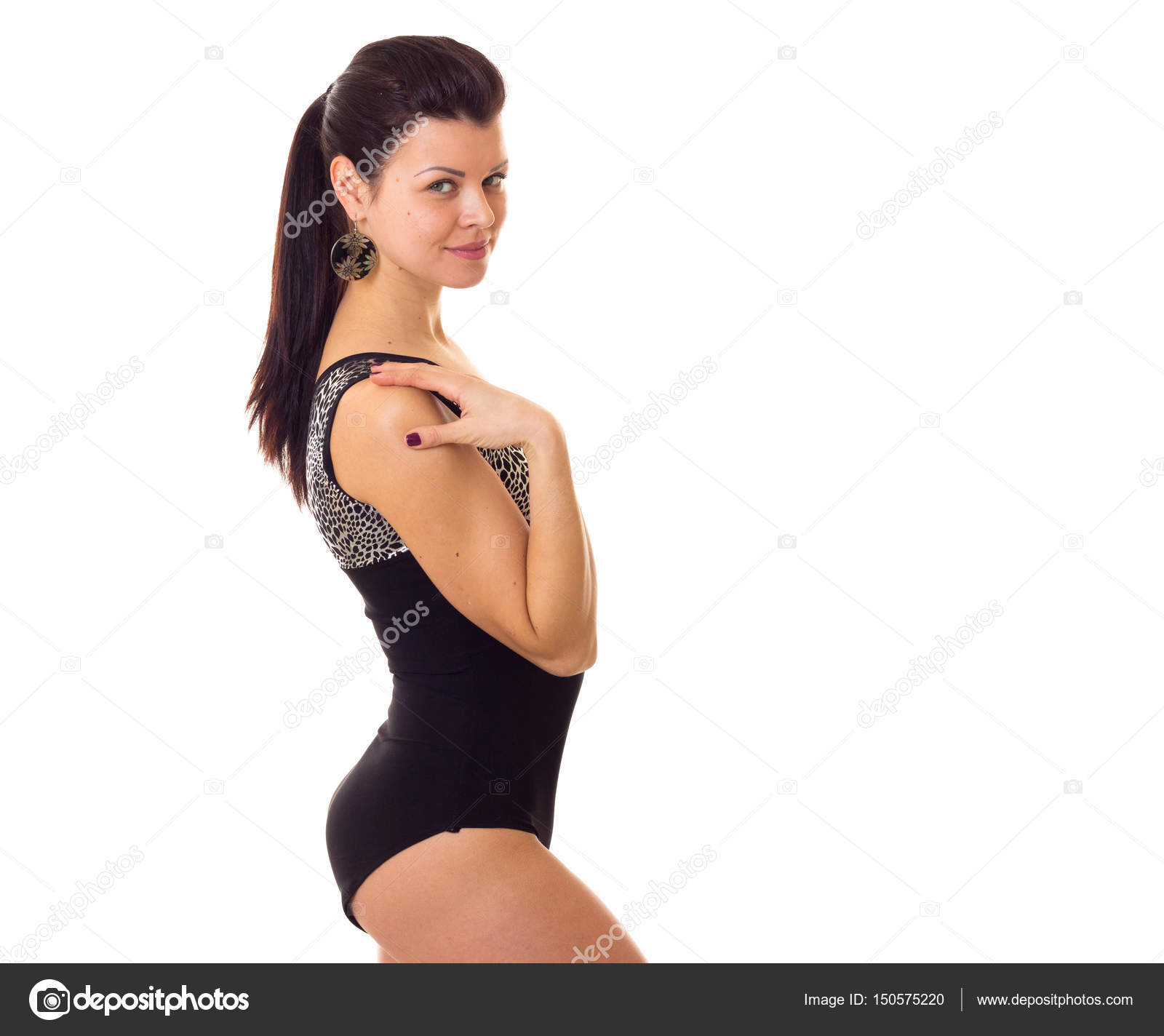 77534b76f60 Young elegant woman with long ponytail and big earrings in black swimming  suit on white background in studio — Photo by Dmitroza
