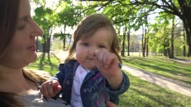 Baby looking in camera in the park