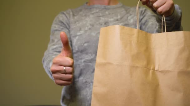 Paper bag and thumbs up to zero waste world
