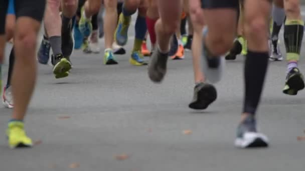 Unrecognizable Slow motion shot of Marathon running race. Unrecognizable People feet on city road