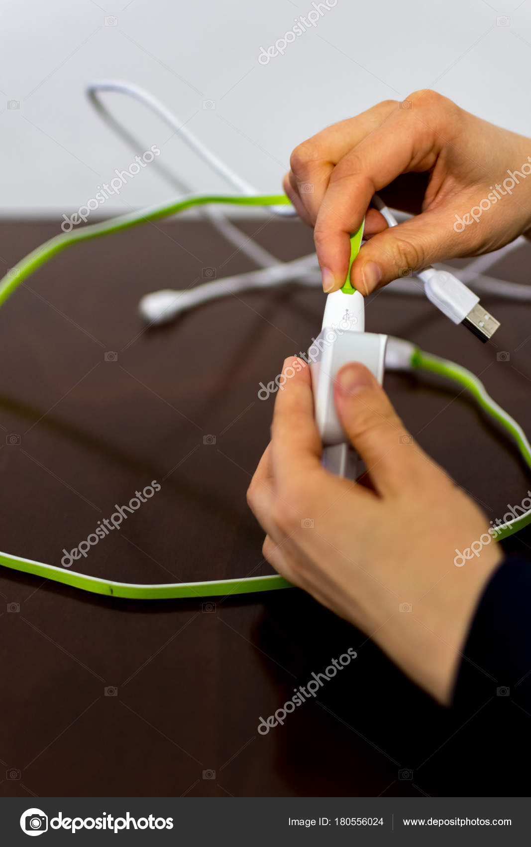 2657007fc39c5b Girl holding two cables and phone charger — Stock Photo © Muamer ...
