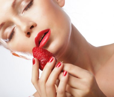 woman with strawberry on the white background