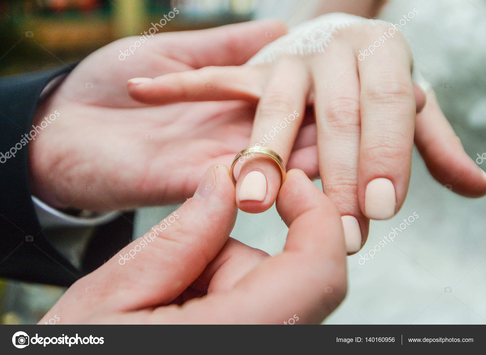 marriage hands with rings. birde wears the ring on the finger of the ...