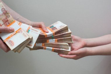 hand with stack of Russian money