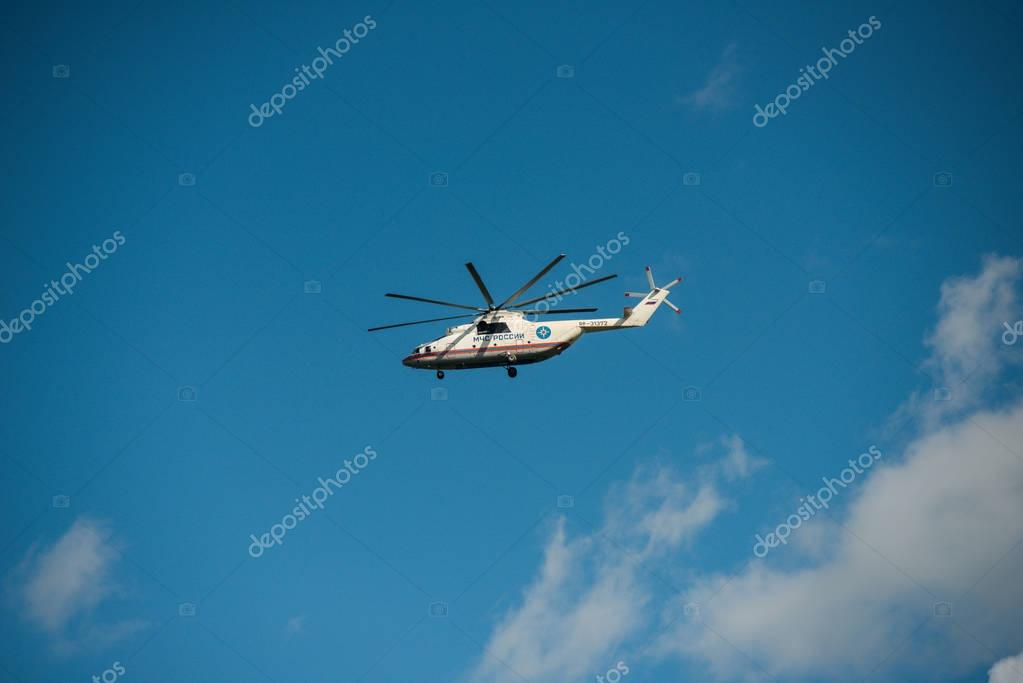 Khabarovsk, Russia - September 3, 2017: Mi-26 heavy military transport in flight in the colors of EMERCOM of Russia
