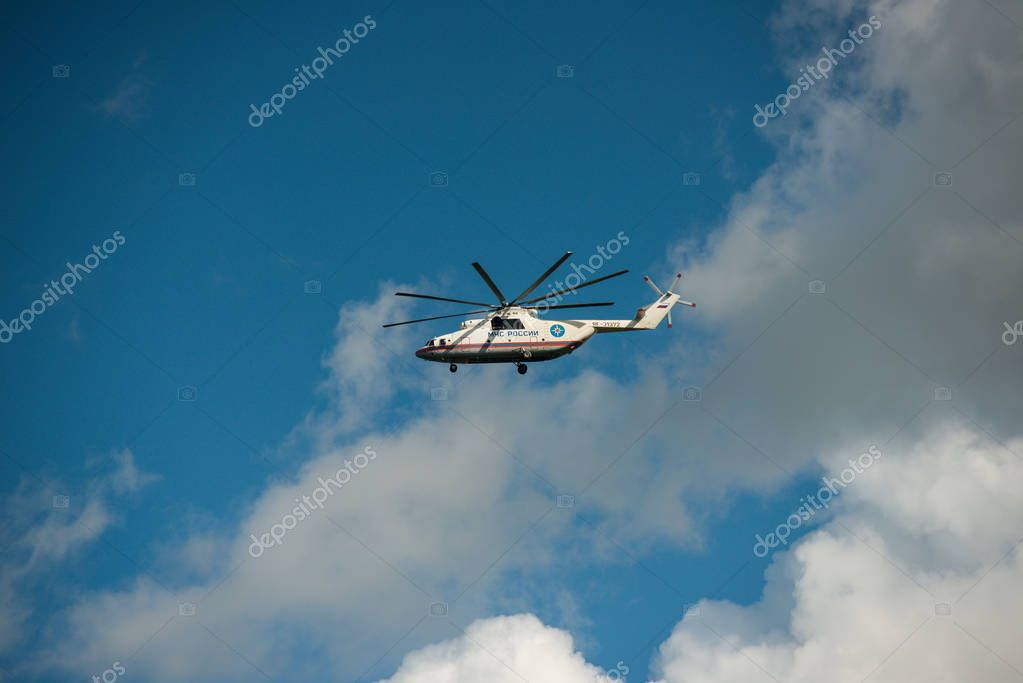 Khabarovsk, Russia - September 3, 2017:Mi-26 heavy military transport helicopter in flight in flight in the colors of EMERCOM of Russia