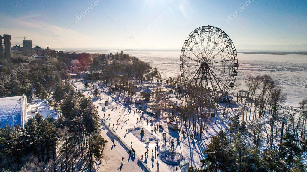 Khabarovsk Ferris wheel the view from the top winter skating rink embankment of the Amur river