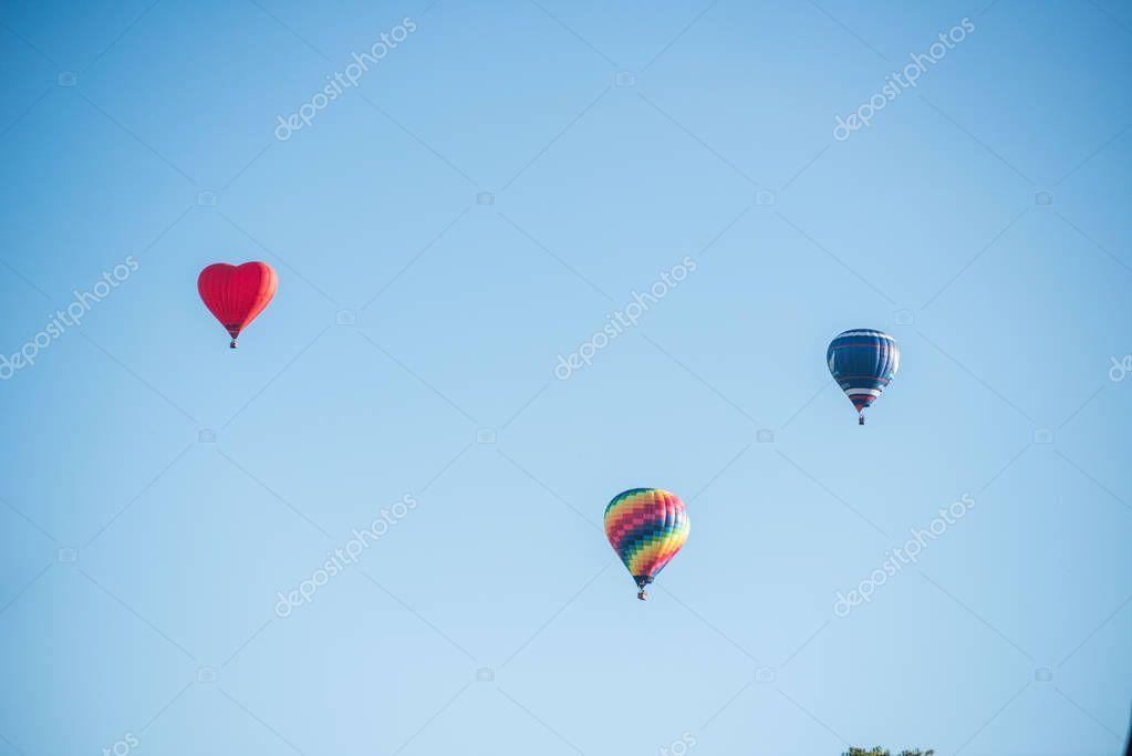 Hot-air balloons cloudy blue sky