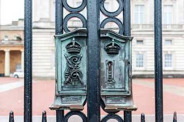 LONDON: Ancient lock on Buckingham Palace Gate - famous landmark. Built in 1705, Palace is official London residence