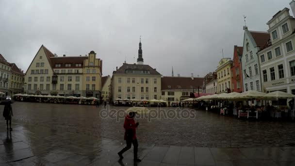 TALLINN, ESTONIA- SEPTEMBER 5, 2015 A crowd of tourists visit Town Hall Square in the rain in the Old city on September 5, 2015 in Tallinn, Estonia