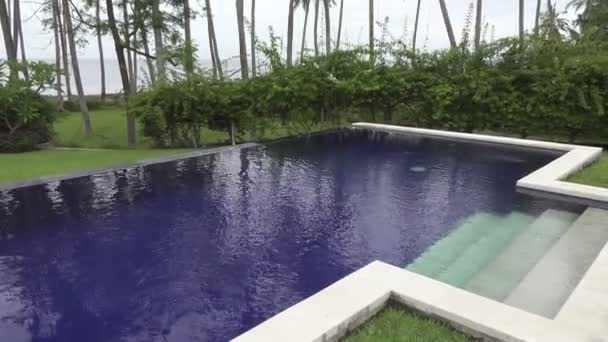 Panoramic view of a palm tree the sea and the pool on tropical the resort of Bali Indonesia