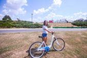 Pretty Woman Having Fun Riding Bicycle