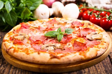 pizza with ham and vegetables
