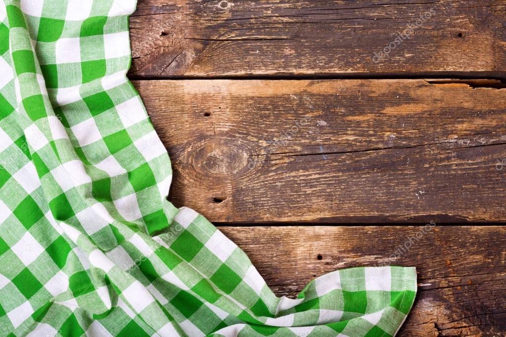 Green tablecloth on wooden table