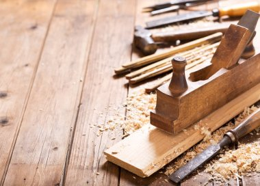 old tools: wooden planer, hammer, chisel  in a carpentry worksho