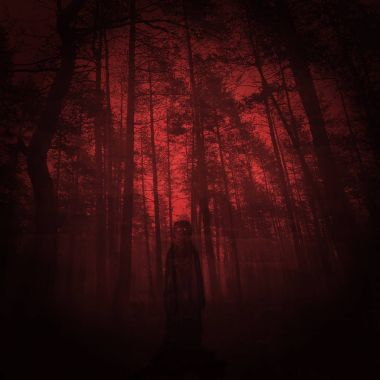 The meeting with an evil creature on the bloody forest - blurred alien figure with glowing eyes.
