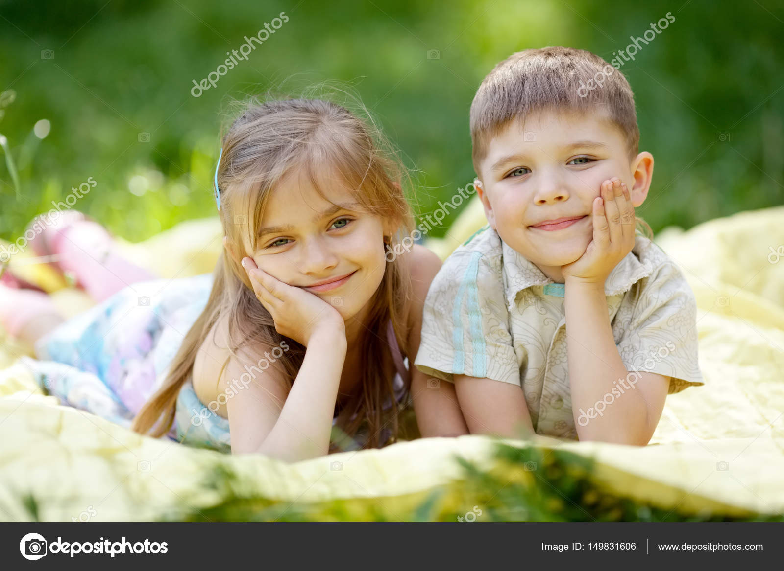 cute boy and girl lying on blanket — stock photo © ababaka #149831606