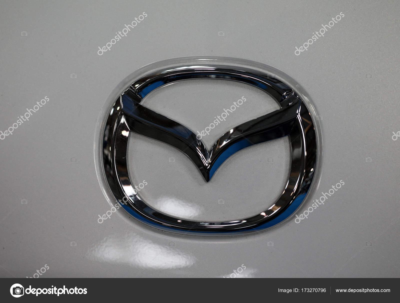 Mazda Metallic Logo Closeup On Mazda Car Displayed At Moto Show In
