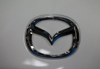 Mazda  metallic logo closeup on Mazda car displayed at  MOTO SHOW in Cracow Poland. Exhibitors present  most interesting aspects of the automotive industry