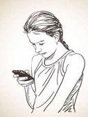 tinédzser lány segítségével okos telefon
