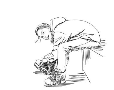 Girl puting on skates