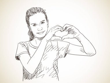 girl showing hands in heart form
