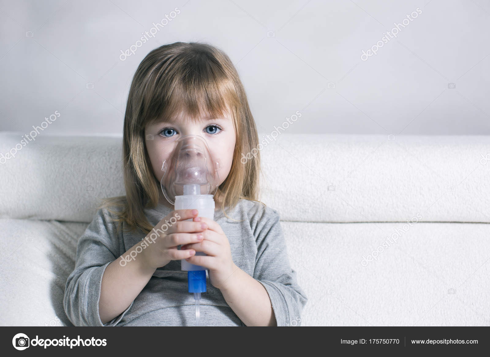 Little girl making inhalation with nebulizer at home child asthma