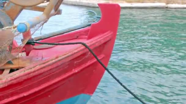Close up of red fishing boat in Aegean sea, Nea Anchialos, Greece