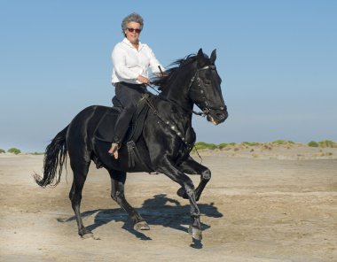 horse woman galloping
