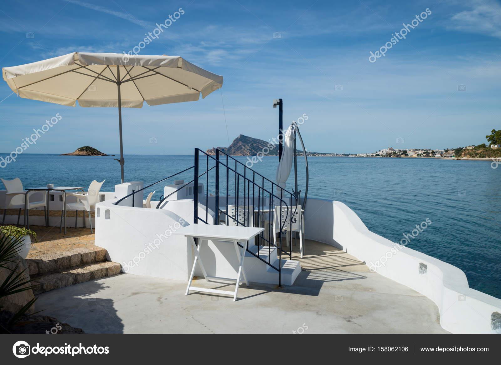 terrasse bord de mer sur la plage de altea photographie olafspeier 158062106. Black Bedroom Furniture Sets. Home Design Ideas
