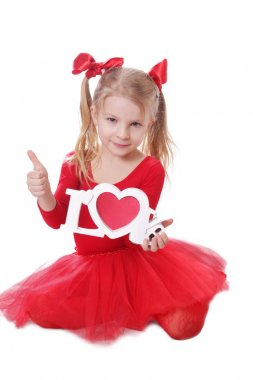 Little girl in red holding love words  on white