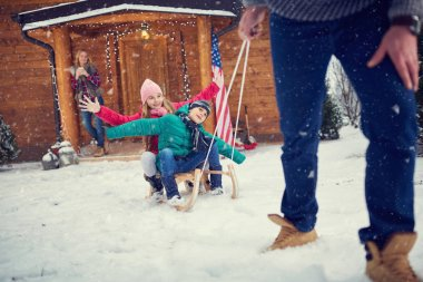 Happy children sledding at winter time-Family time stock vector