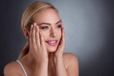 middle age woman tightening skin on face