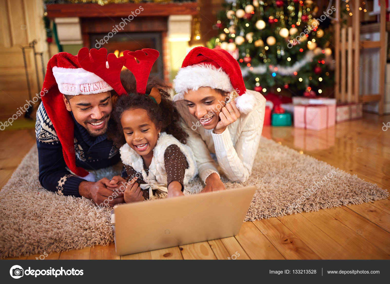 family decorate house together outdoor for christmas photo by luckybusiness - African American Outdoor Christmas Decorations