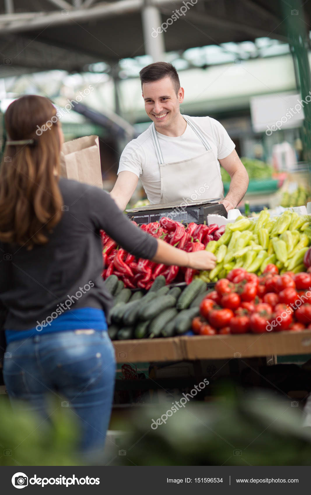 smile salesman presentation vegetables on stalk stock photo