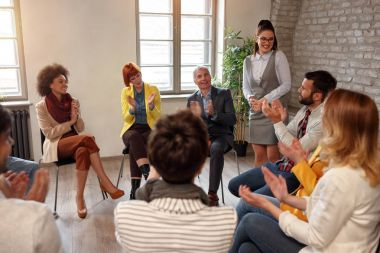 Creative business people meeting in circle