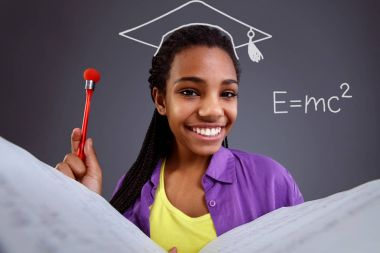 Education in school - schoolgirl doing math equation