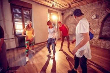 young hip hop dancers dancing in the studio. Sport, dancing