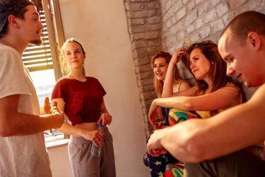 denser people enjoying on break at dances in studio