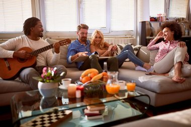 Friends socializing in apartment