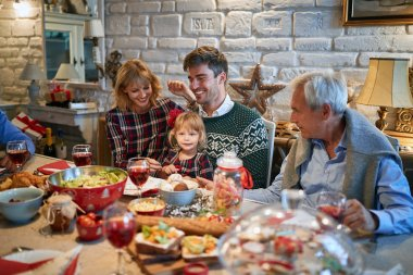 Happy family enjoying Christmas holidays together