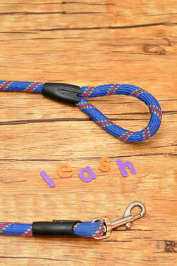 A blue leash for a dog with the word leash