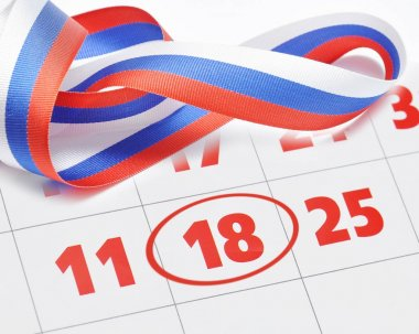 Ribbon bow in colors of Russian flag on the calendar.