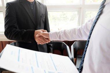 Job applicant having interview. Handshake success job interviewi