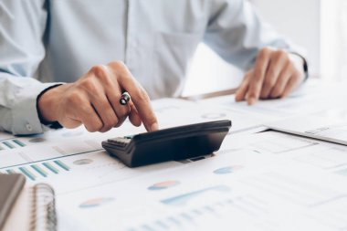 Male accountant or banker use calculator.