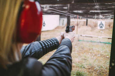 Woman Shooting With Gun