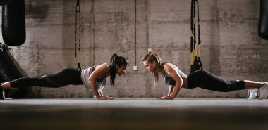 Young muscular girls doing plank